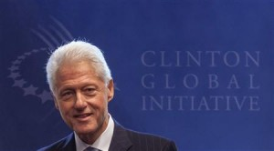 Former U.S. President Clinton stands in front of the logo of the Clinton Global Initiative 2012 prior to a meeting with Malawi President Banda in New York